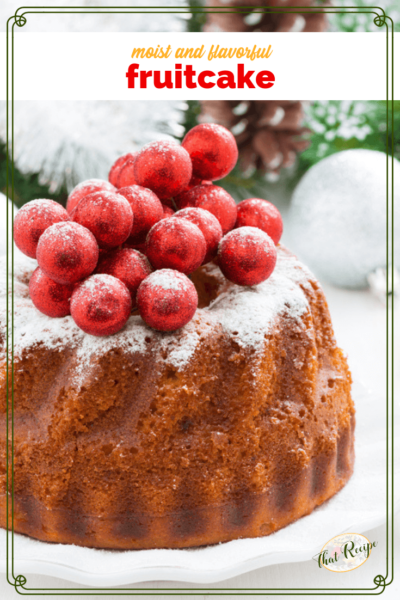 fruitcake on a plate with decorations on top
