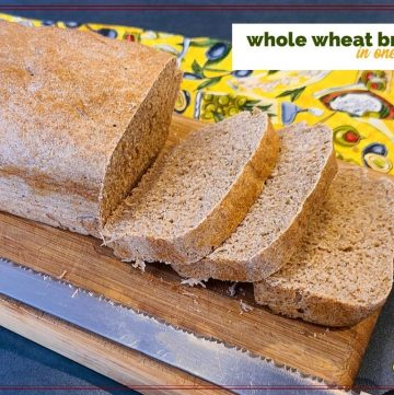 """loaf of whole wheat bread on a cutting board with a bread knife and text overlay """"Whole Wheat Bread in one hour"""""""