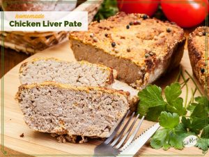 "loaf and slices of chicken lover pate on a cutting board with text overlay ""homemade chicken liver pate"""