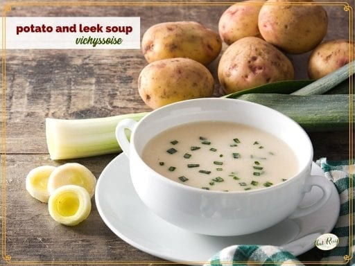 """potato soup in a bowl surrounded by potatoes and leeks and text overlay """"vichyssoise potato and leek soup"""""""