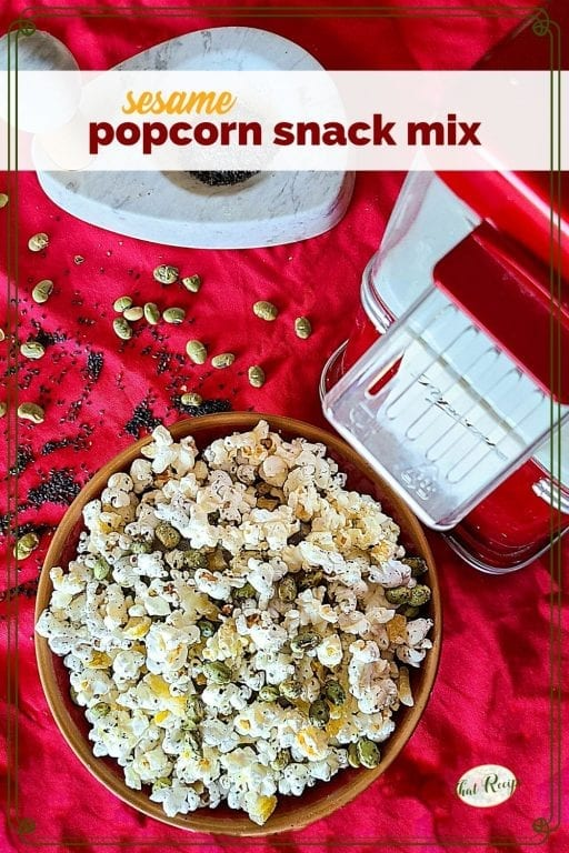 "bowl of popcorn snack mix with text overlay ""sesame popcorn snack mix"""