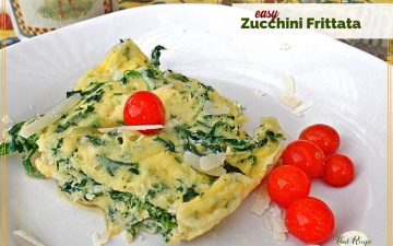 """Frittata on a plate with cherry tomatoes and ext overlay """"easy zucchini frittata""""."""