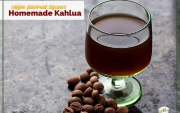 "glass of liqueur on a table with coffee beans and text overlay ""coffee flavored liqueur Homemade Kahlua"""