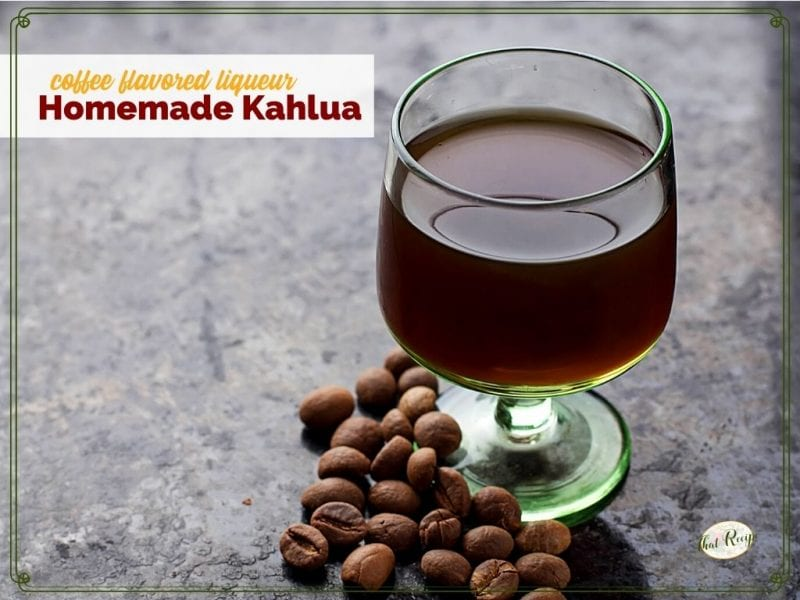 """glass of liqueur on a table with coffee beans and text overlay """"coffee flavored liqueur Homemade Kahlua"""""""