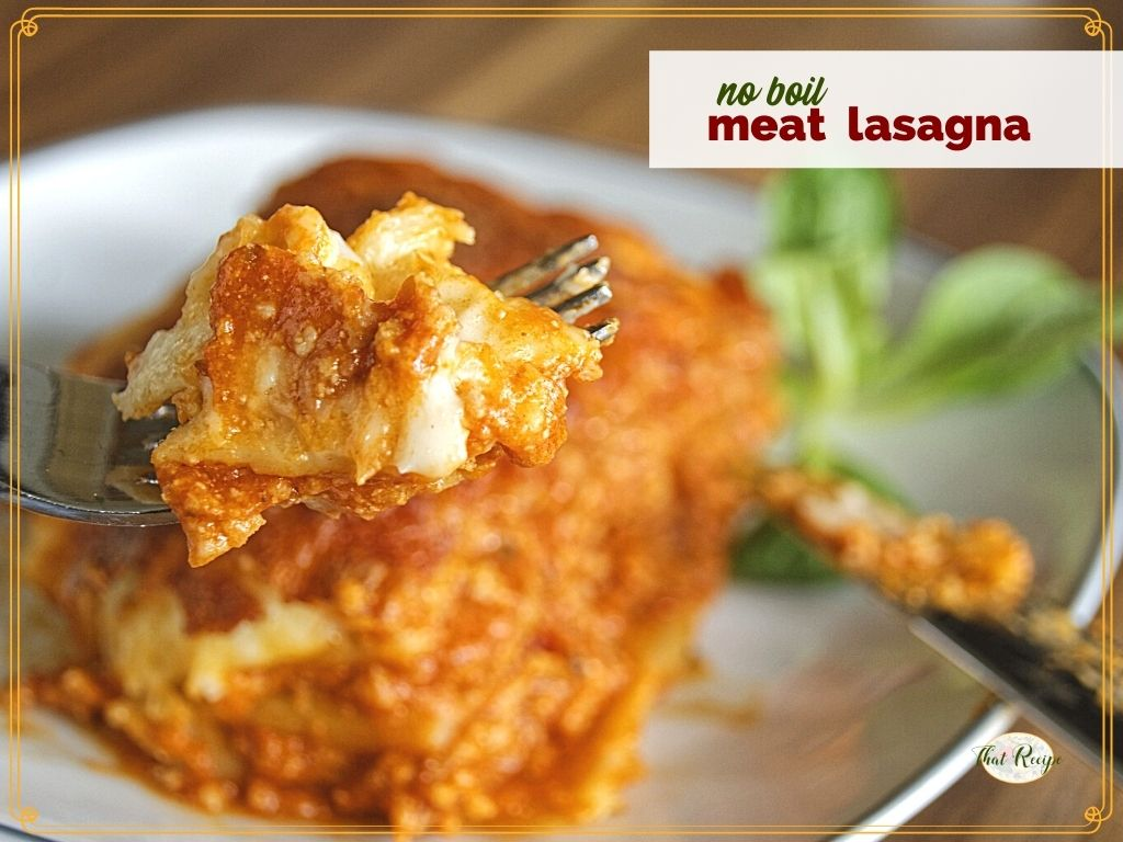 """fork holidng a piece of lasagna with text overlay """"no boil meat lasagna"""""""