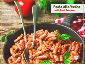 """pasta in a skillet with text overlay """"Pasta alla Vodka with fresh tomatoes"""""""
