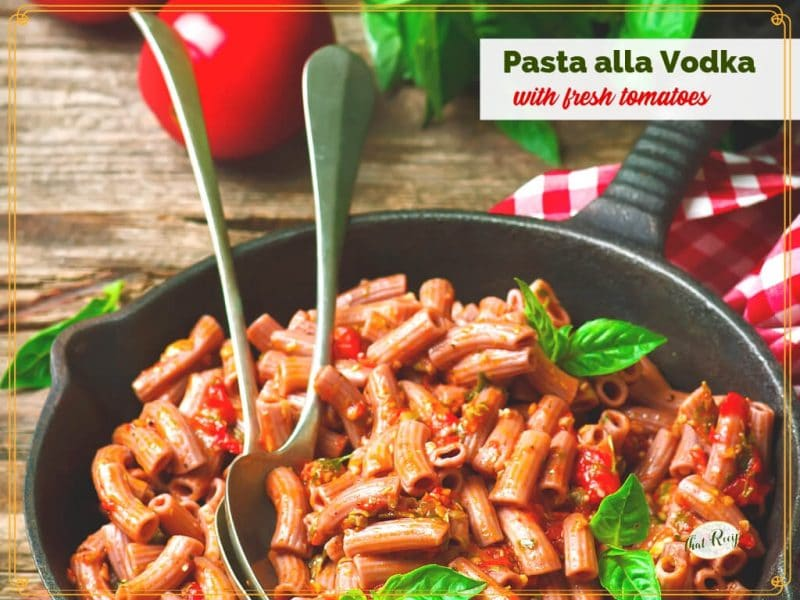 "pasta in a skillet with text overlay ""Pasta alla Vodka with fresh tomatoes"""