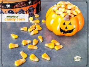 """homemade candy corn overflowing a container with text overlay """"homemade candy corn"""""""