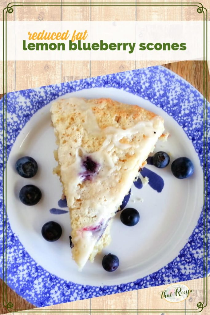 lemon blueberry scone on a plate with fresh blueberries