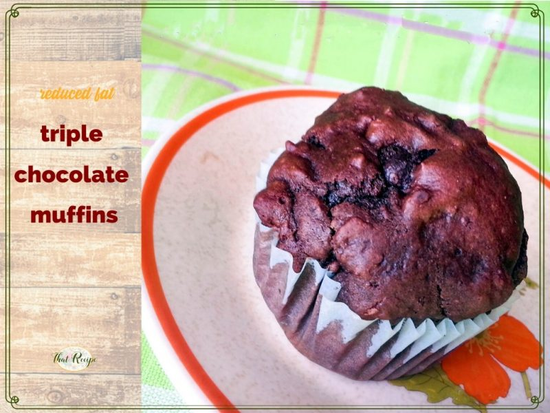 """triple chocolate muffin on a plate with text overlay """"reduced fat triple chocolate muffin"""""""