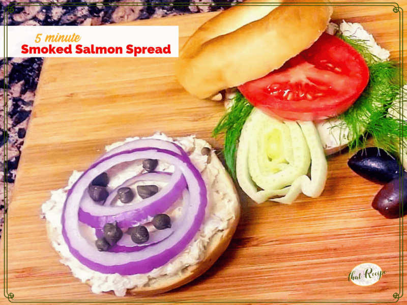 "bagel with salmon spread on bagel with vegetables and text overlay ""Smoked Salmon Spread"""