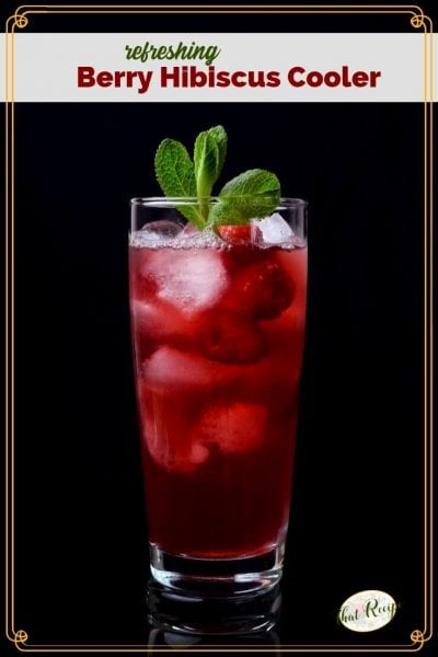 "glass of hibiscus tea with raspberries and text overlay ""Berry Hibiscus Cooler"""