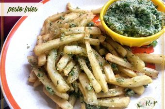pesto fries on a plate with a side of homemade pesto