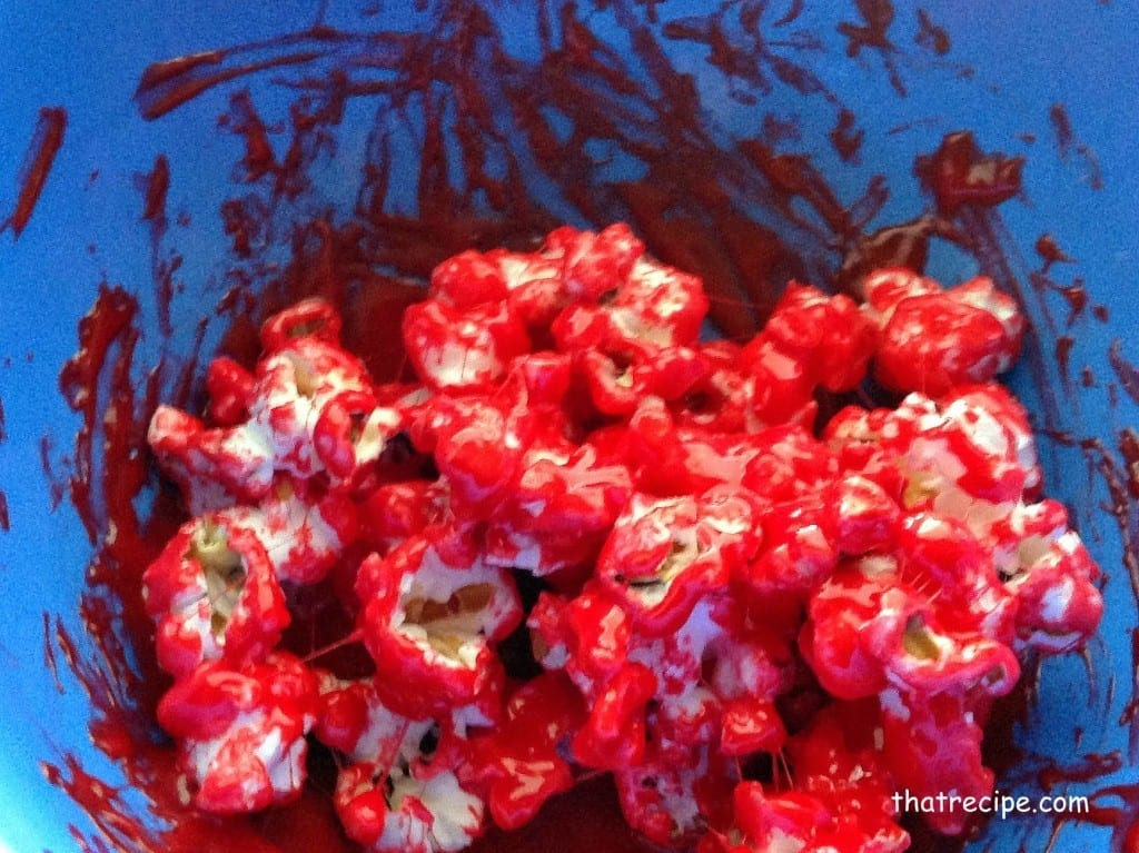 Red colored marshmallow and popcorn