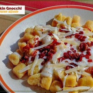 pumpkin gnocci with bacon alfredo sauce on a plate