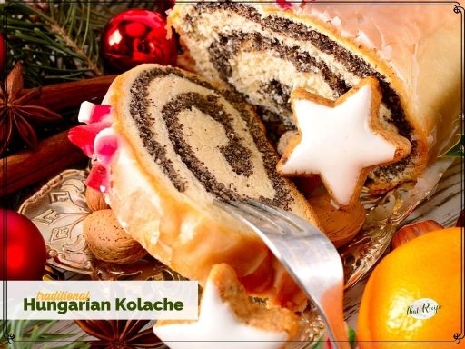 "poppy seed roll on a plate with text overlay ""traditional Hungarian Kolache"""