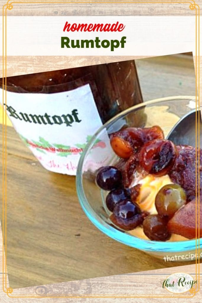 bottle of rumtopf with rum soaked fruit on ice cream in a bowl