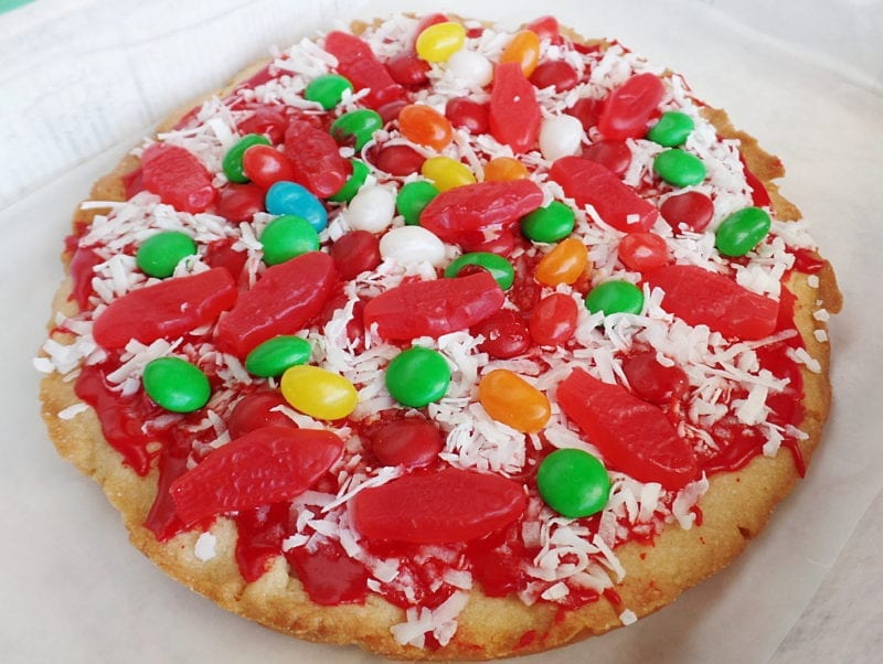 A giant sugar cookie decorated like a Pepperoni Jalapeno Jelly Bean Pizza with Anchovies the Ninja Turtles would love. April Fools Day dessert, faux foods.