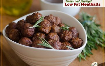"bowl of meatballs with rosemary garnish and text overlay ""tender and flavorful low fat meatballs"""