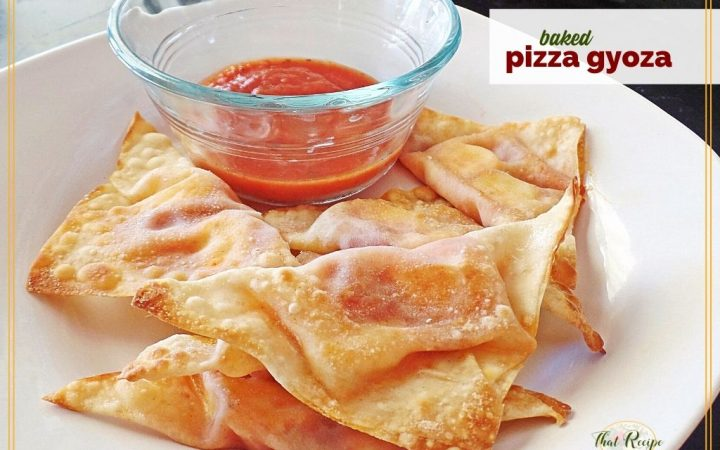 """baked wontons on a plate with marinara sauce and text overlay """"baked pizza gyoza"""""""