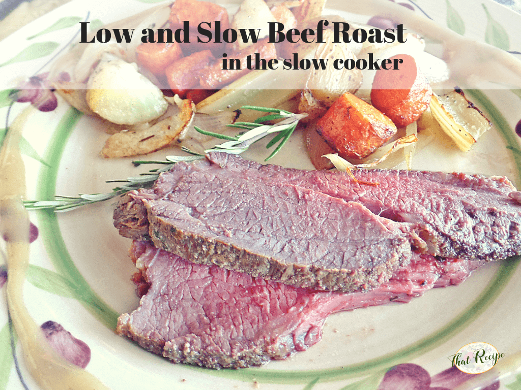 Beef roast on a plate with roasted root vegetables