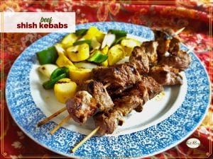 """shish kebabs and grilled vegetables on a plate with text overlay """"beef shish kebabs"""""""