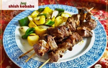 "shish kebabs and grilled vegetables on a plate with text overlay ""beef shish kebabs"""