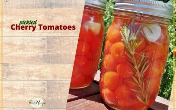 """cherry tomatoes in a jar with text overlay """"pickled cherry tomatoes"""""""