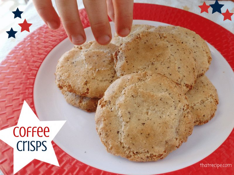 """hand sneaking a cookie off of a plate with text overlay """"Crispy Coffee"""""""