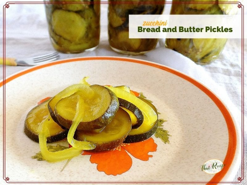 """pickle slices on a plate with text overlay """"zucchini bread and butter pickles"""""""