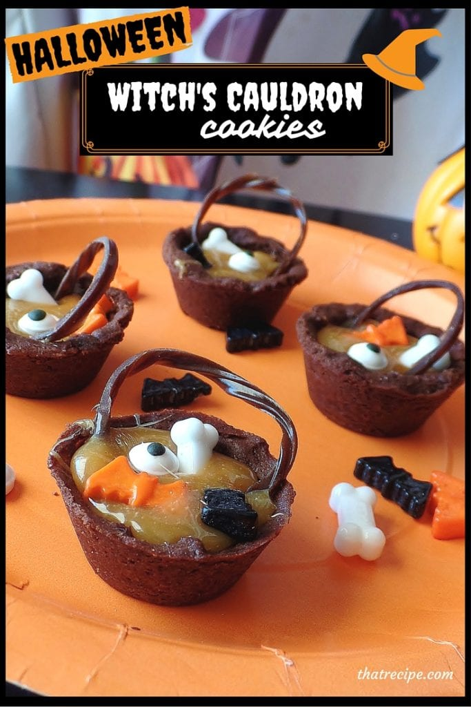 Witch's Cauldron Cookies - chocolate and caramel cauldron's filled with candy eyes, bones and bats for a spooky Halloween treat. #Halloween #cookies