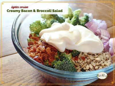 """bacon and broccoli salad ingredients in a bowl with text overlay """"lighter version creamy bacon and broccoli salad"""""""