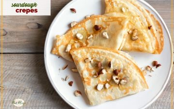 """top down view of crepes on a plate with text overlay """"sourdough crepes"""""""