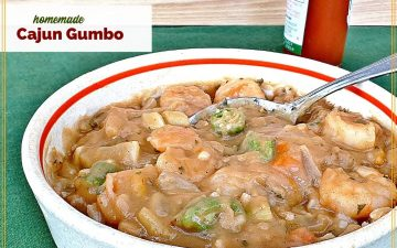 """bowl of gumbo with bottle of hot sauce and text overlay """"homemade cajun gumbo"""""""