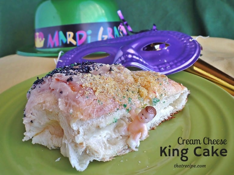 """King Cake on a table with text overlay """"Cream Cheese filled King Cake"""""""