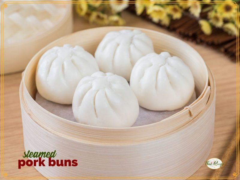 """pork buns in a bamboo steamer with text overlay """"steamed pork buns"""""""