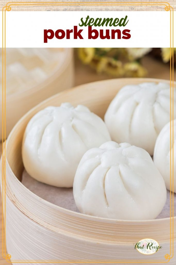 "pork buns in a bamboo steamer with text overlay ""steamed pork buns"""