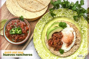 huevos rancheros on a plate with tortillas and a bowl of salsa