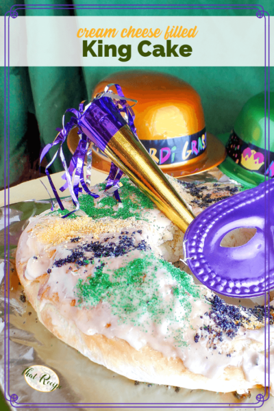 "King Cake on a table with text overlay ""Cream Cheese filled King Cake"""