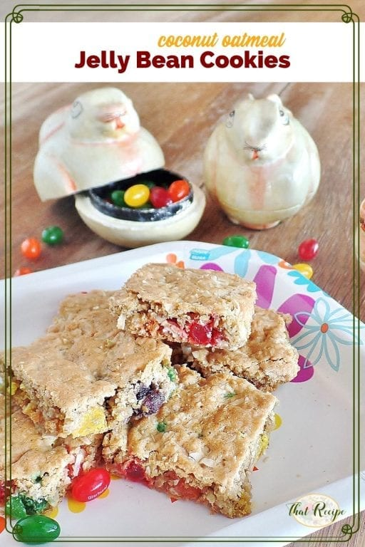 """cookie bars on a plate with bunny shaped jelly bean holders and text overlay """"coconut oatmeal jelly bean cookies"""""""