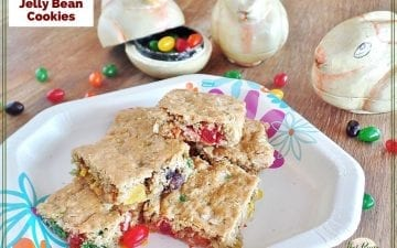 "cookie bars on a plate with bunny shaped \jelly bean holders and text overlay ""coconut oatmeal jelly bean cookies"""