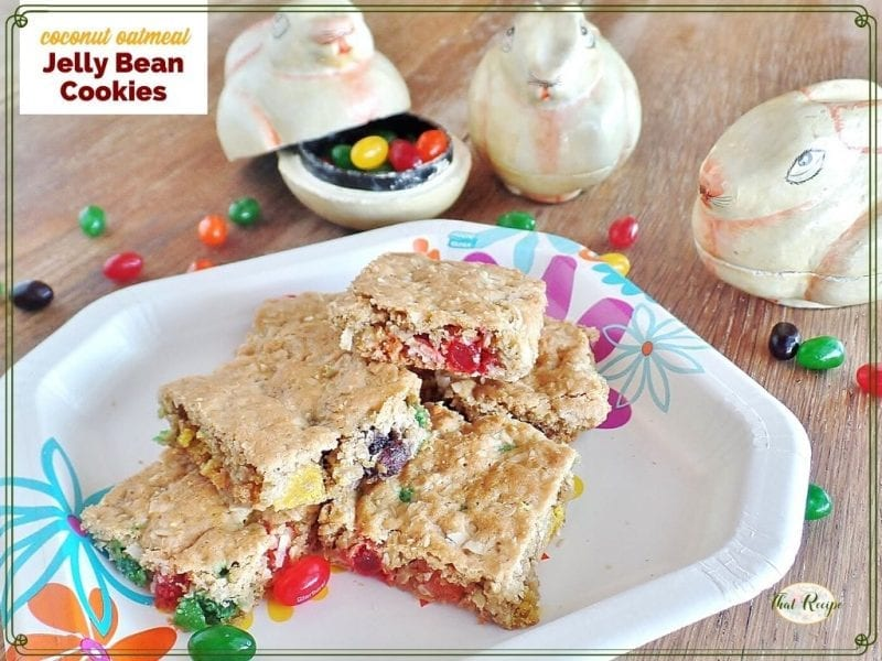 """cookie bars on a plate with bunny shaped \jelly bean holders and text overlay """"coconut oatmeal jelly bean cookies"""""""