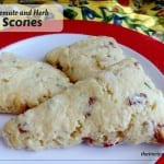 """scones on a plate with text overlay """"tomato and herb scones"""""""