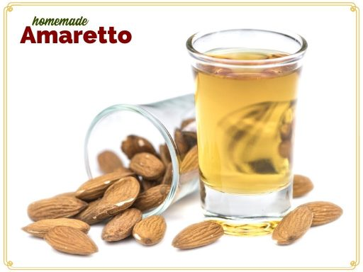 """Amaretto in a cordial glass surrounded by almonds with text overlay """"homemade Amaretto"""""""