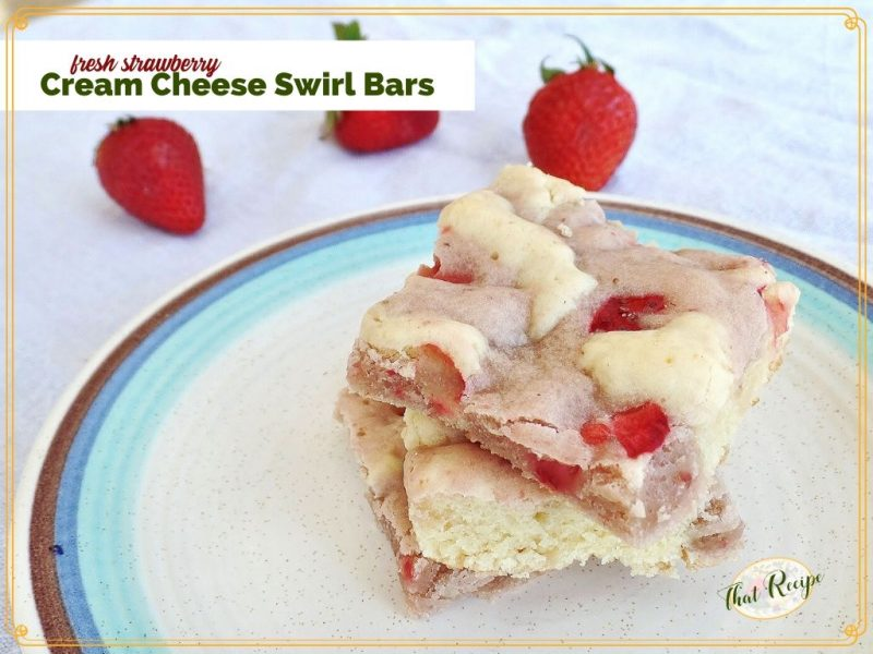 """cookie bars on a plate with fresh strawberries in the background with text overlay """"Fresh Strawberry Cream Cheese Swirl Bars"""""""