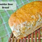 Cheddar Beer Bread - easy quick bread made with beer and loaded with cheddar cheese in and on top of the bread.