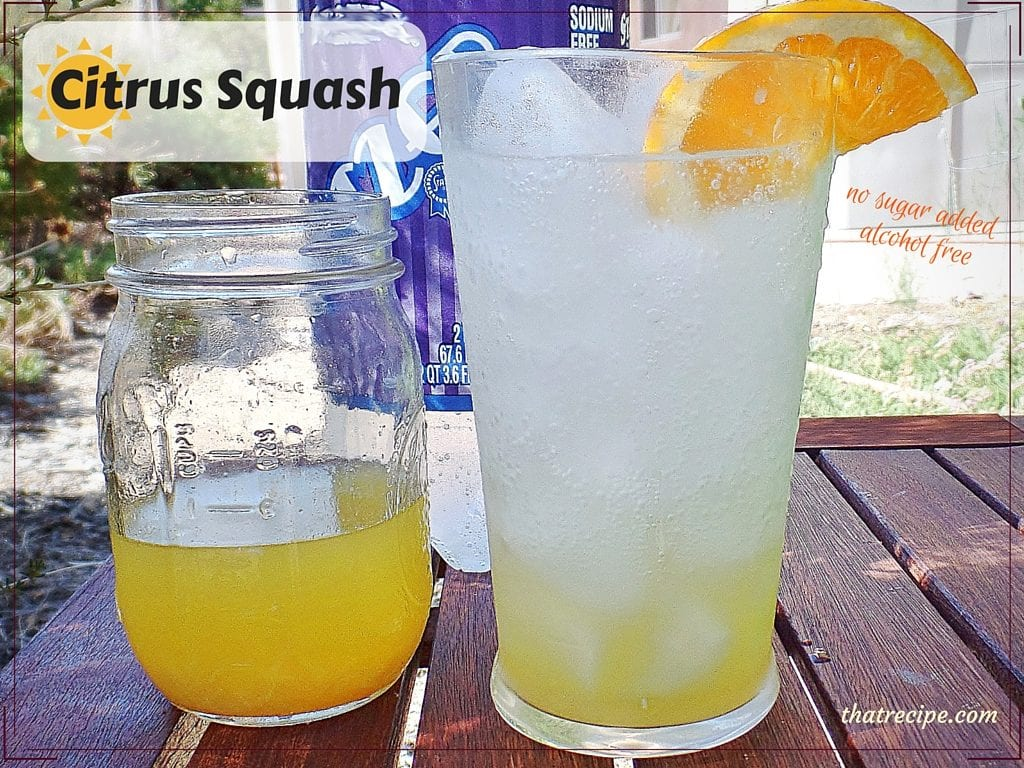 Summer drink on a table with a jar of citrus concentrate and seltzer