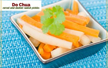 "matchstick carrots and radish in a square bowl with text overlay ""Do Chua - Vietnamese carrot and Daikon radish pickles"""