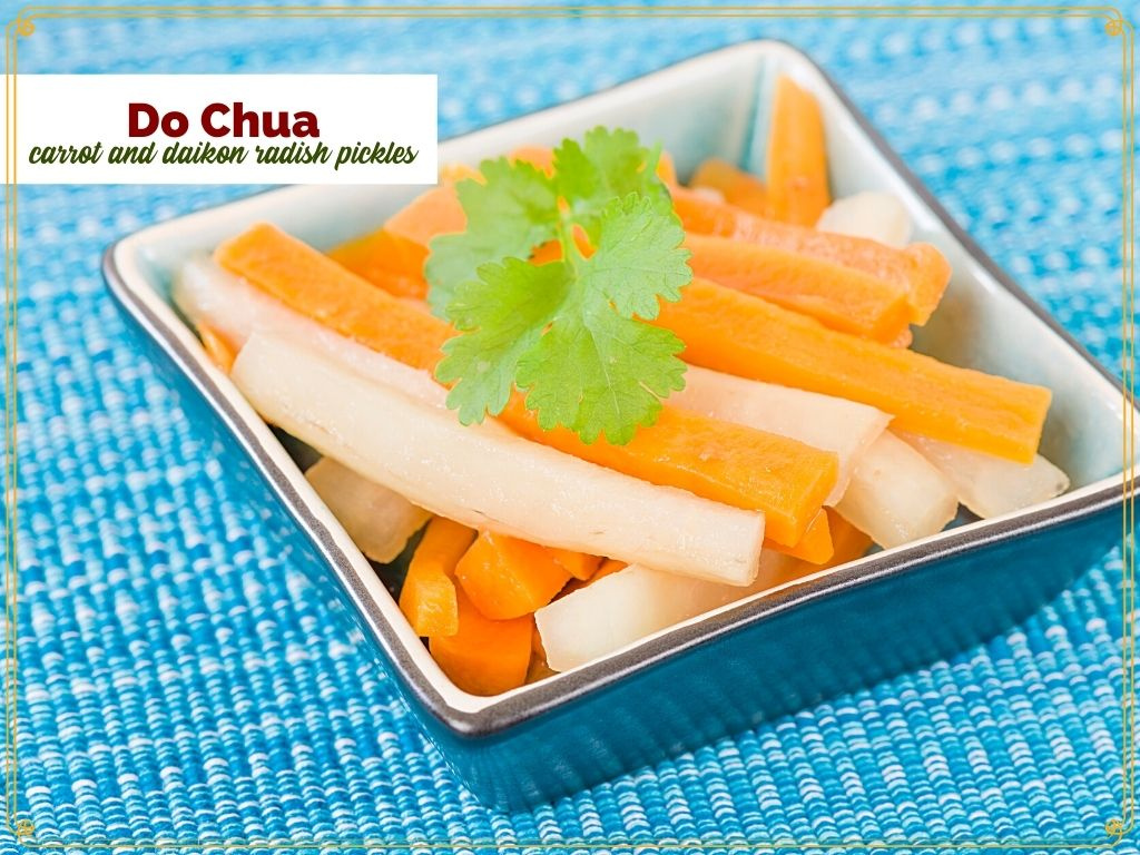 """matchstick carrots and radish in a square bowl with text overlay """"Do Chua - Vietnamese carrot and Daikon radish pickles"""""""