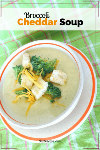 bowl of cheddar and broccoli soup with text overlay
